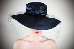 Languettes dans le chapeau Image stock