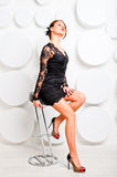 Languid girl in sexy dress on  chair Stock Images