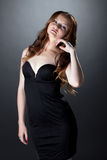 Languid red-haired girl posing in skin-tight dress Royalty Free Stock Image