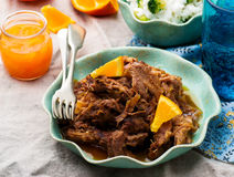 Langzaam Kooktoestel Gesmoord Varkensvlees met een rum-Oranje Saus stock afbeeldingen