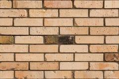 Langzaam verdwenen bakstenen muurachtergrond Gekleurde bakstenenvoorgevel royalty-vrije stock afbeeldingen