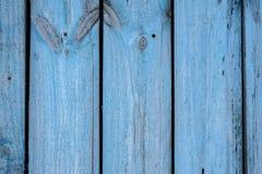 Langzaam verdwenen blauwe oude houten planking achtergrond met barsten stock afbeeldingen