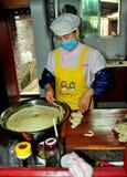 Langzhong, China: Woman Preparing Noodle Dough Royalty Free Stock Photos