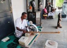 Lankan man grinds moonstone Royalty Free Stock Image