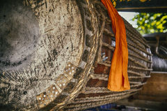Lanna Drum. Thai traditional lanna drum in the temple and the monk who take care of it Royalty Free Stock Images