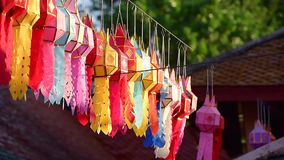 Lanna lantern hang on the rope to wish a desire or hope for good thing to happen, in northern thai style lanterns at Loi Krathong. Yi Peng Festival, Chiang Mai stock video footage