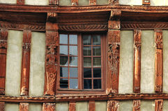 Lannion (Brittany): haòf-timbered house. Lannion (Cote-d'Armor, Brittany, France): facade of old typical half-timbered house: a window Stock Images