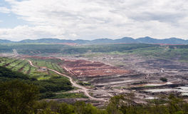 Lanscape of coalmine with cloudy and mountain Stock Image