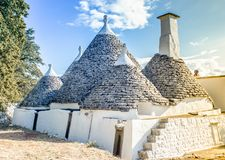 Lanscape of a farm composed of ancient restored trulli. Currently used as homes for summer holidays royalty free stock photography