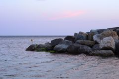 Lanscape photo of open nature scope with pile of rocks in the se royalty free stock photos