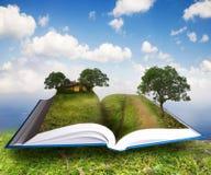 Lanscape rural en libro abierto Fotos de archivo libres de regalías