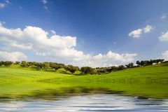 Lanscape in Spring Season. With blue sky and water reflex Royalty Free Stock Images