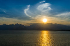Lanscape of sunset over mountains and sea Royalty Free Stock Photos