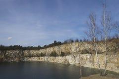 Cliff stone quarry lake in Krakow Zakrzowek. Spring pond landscape scenery, true pure Poland nature. Royalty Free Stock Images
