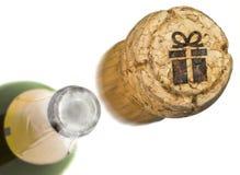 Lanserad champagnekork med formen av en gåva brände in Serie Royaltyfri Fotografi
