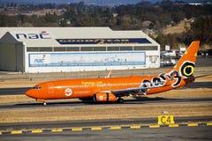 Lanseria Airport - SAA - Mango - Boeing 737-8BG. Mango (South African Airways) Boeing 737 - ZS-SJG, on the runway, Lanseria International Airport with the NAC stock photo