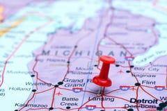 Lansing ha appuntato su una mappa di U.S.A. fotografie stock libere da diritti