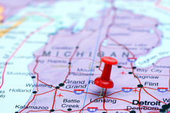 Lansing pinned on a map of USA. Photo of pinned Lansing on a map of USA. May be used as illustration for traveling theme Royalty Free Stock Photos