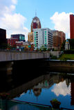 Lansing Skyline on the Grand River. The Lansing skyline is reflected in the Grand River stock photos