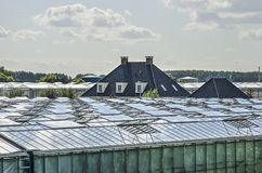 Lantbrukarhem och växthus royaltyfria bilder
