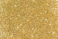 Lantejoulas do ouro Brilho brilhante Pó amarelo glitter Brilho para trás Fotos de Stock Royalty Free
