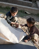 Lanten Hill Tribe Boys making Paper Royalty Free Stock Photography