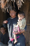 Lanten Woman with Child. A Lanten Hill Tribe woman in northern Laos hold her young child near her house Stock Photos