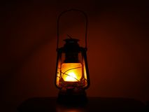 Lantern #1. A glowing kerosene oil lantern in dark stock photo