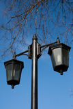 Lantern. Black metal street lamp against blue sky stock photo