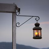 Lantern. Old romantic lantern in front of the sunset Royalty Free Stock Image