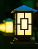 Few yellow lanterns in dark Stock Photos