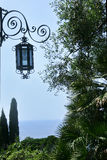 Lantern. View of the Mediterranean, from the garden of the Hunbury mansion, in Ventimiglia, to the flower Riviera, ItalyA view on the castle at the coast of stock image