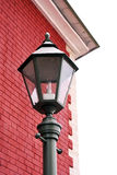 Lantern. Classical lamp post near the corner of the building Royalty Free Stock Photography