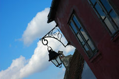 Lantern. Sillhouete of a street lamp against cloudy blue skies Stock Photography