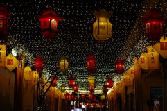 Chinese New Year. Lantern and spotlight shining in the night sky Stock Photos