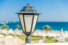 Lantern against the sea Stock Image