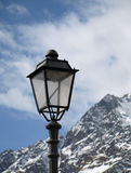Lantern in the Alps. Lantern on a background of mountains and the sky Royalty Free Stock Photography