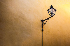 Lantern in ancient style on a yellow wall, minimalism. Royalty Free Stock Photos