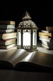 Lantern And Many Books Late At Night Royalty Free Stock Photo