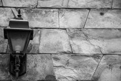 Lantern. Antique lantern on a wall of stones Stock Images