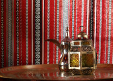 Lantern and arabic teapot. With textured background Royalty Free Stock Photography