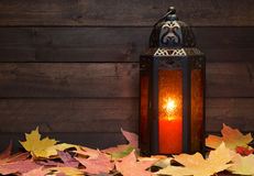 Lantern and Autumn Leaves Royalty Free Stock Image
