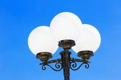 Lantern on  background of blue sky. Royalty Free Stock Image