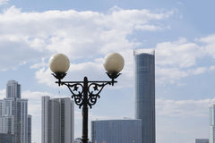 lantern on the background of skyscrapers and sky Stock Photography