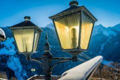 Lantern backlit by the sun. With snowy mountains in the background Royalty Free Stock Images