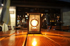 The lantern on bar table stock image