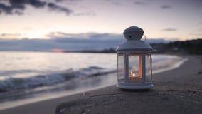 Lantern on the beach stock video
