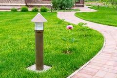 Lantern in a beautiful garden Stock Photos