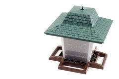 Lantern Bird Feeder. Plastic container with perches and roof to feed our feathered friends on white background Stock Photos