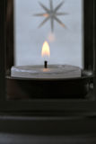 Lantern black with burning candles Stock Images